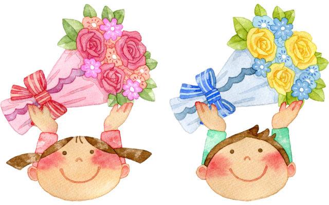 お父さんへ、花束を捧げる可愛い男女の子供たち